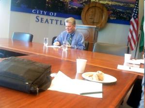 So với các thị trưởng tiền nhiệm, Nickels khét tiếng là người áp dụng chính sách top-down approach--không hề biết lắng nghe và bảo vệ quyền công dân của cư dân trong thành phố, nhất là người nghèo và thiểu số. Bài bình luận trên báo SeattleWeekly cho rằng Nickels là tay trong/tay ngoài của các nhóm đầu tư địa ốc kết sù ở tiểu bang và toàn quốc để trục lợi. Thử hỏi tại sao lương hướng của ông ta chỉ cỡ trên một trăm ngàn nhưng phải bỏ ra hàng triệu bạc để được tái đắc cử?