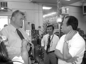 Mayor Greg Nickels, left, meets with Viet Wah grocery store owner Duc Tran, right. International Examiner Photo, August 8 & September 2, 2008